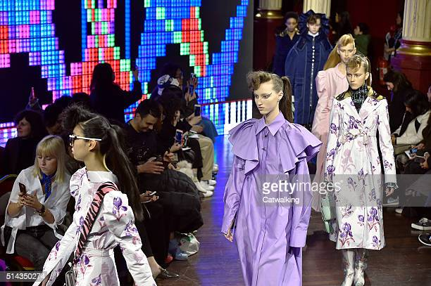Models walk the runway at the Kenzo Autumn Winter 2016 fashion show during Paris Fashion Week on March 8 2016 in Paris France