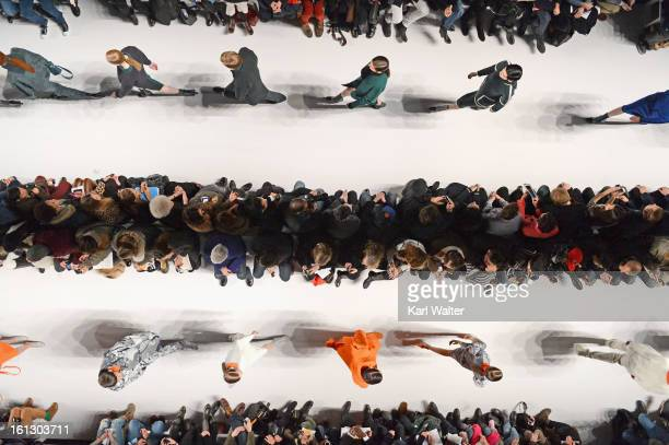Models walk the runway at the Lacoste fashion show during Fall 2013 MercedesBenz Fashion Week at Lincoln Center for the Performing Arts on February 9...