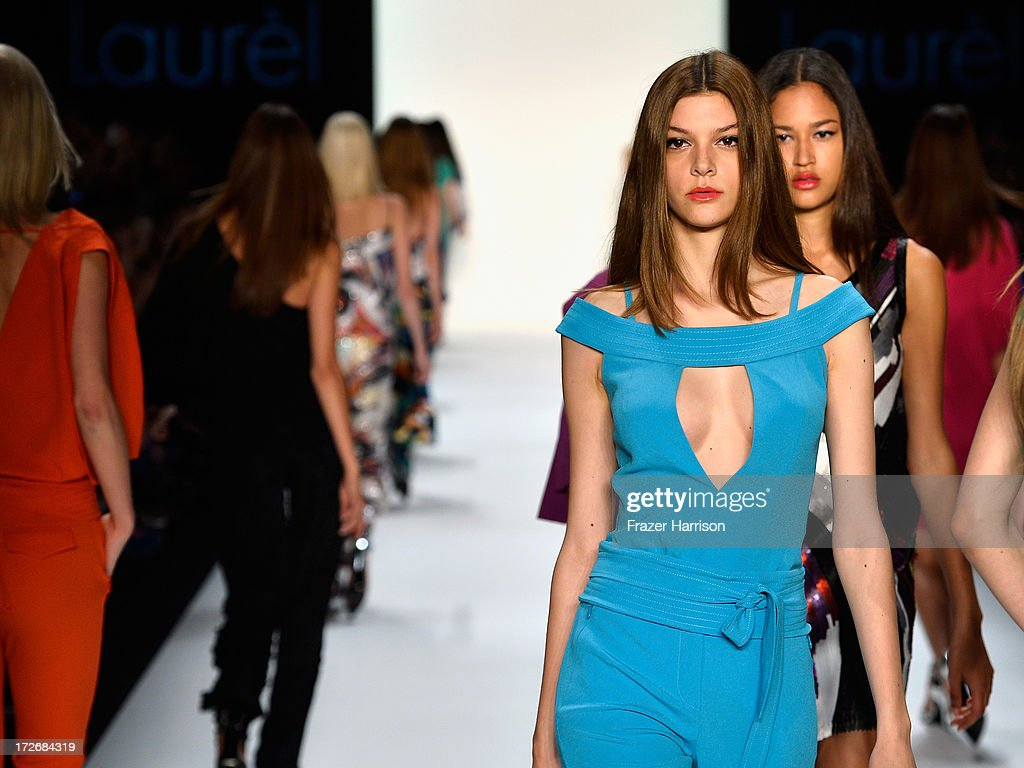 Models walk the runway at the Laurel Show during the Mercedes-Benz Fashion Week Spring/Summer 2014 at Brandenburg Gate on July 4, 2013 in Berlin, Germany.