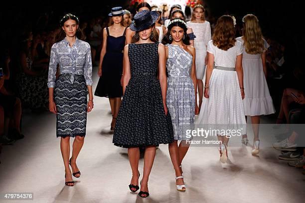 Models walk the runway at the Lena Hoschek show during the MercedesBenz Fashion Week Berlin Spring/Summer 2016 at Brandenburg Gate on July 7 2015 in...