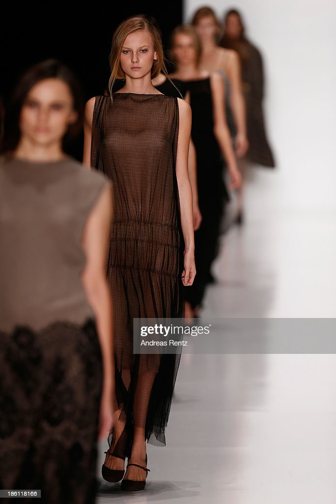 Models walk the runway at the Lena Tsokalenko show during Mercedes-Benz Fashion Week Russia S/S 2014 on October 28, 2013 in Moscow, Russia.
