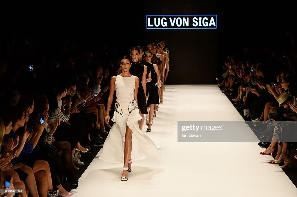 Models walk the runway at the Lug Von Siga show during Mercedes-Benz Fashion Week Istanbul s/s 2014 presented by American Express on October 8, 2013 in Istanbul, Turkey.