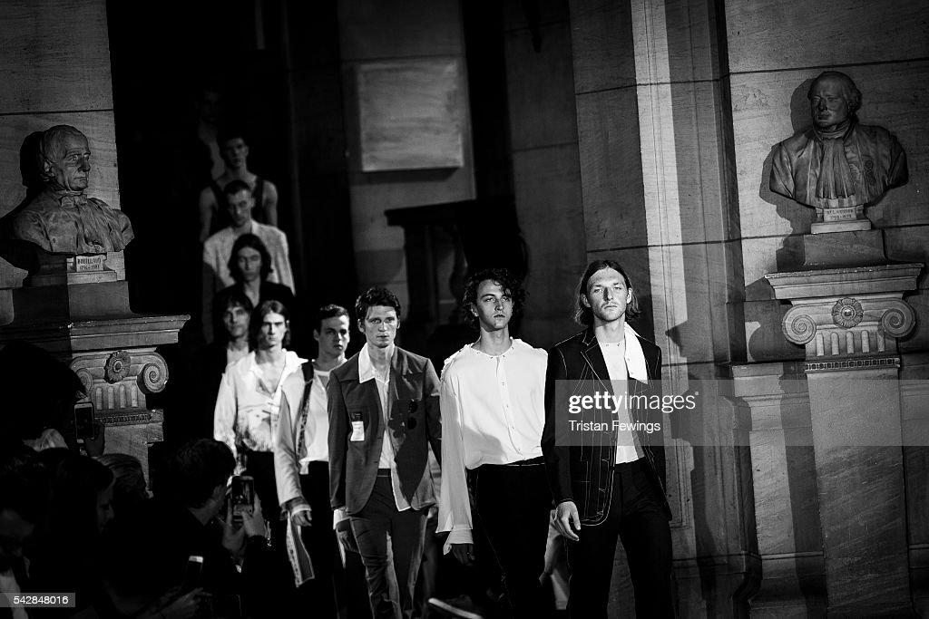 Models walk the runway at the Maison Margiela Menswear Spring/Summer 2017 show as part of Paris Fashion Week on June 24, 2016 in Paris, France.