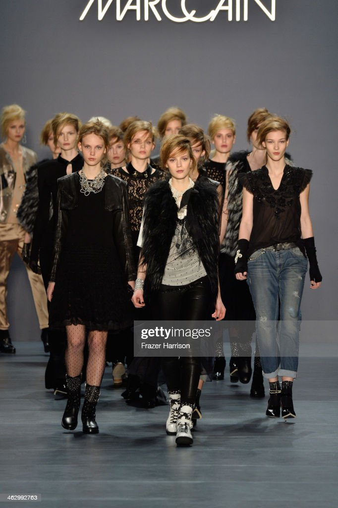 Models walk the runway at the Marc Cain show during Mercedes-Benz Fashion Week Autumn/Winter 2014/15 at Brandenburg Gate on January 16, 2014 in Berlin, Germany.