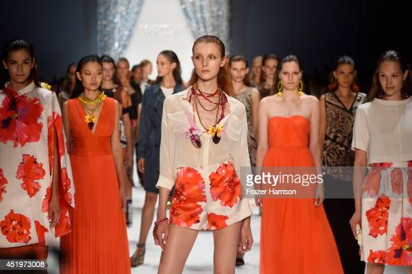 Models walk the runway at the Marc Cain show during the MercedesBenz Fashion Week Spring/Summer 2015 at Erika Hess Eisstadion on July 10 2014 in...
