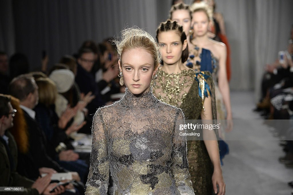 Models walk the runway at the Marchesa Autumn Winter 2014 fashion show during New York Fashion Week on February 12, 2014 in New York, United States.