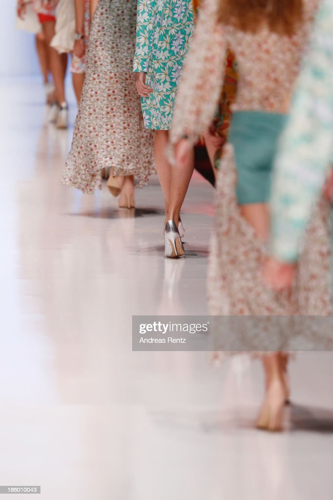 Models walk the runway at the MARI AXEL show during Mercedes-Benz Fashion Week Russia S/S 2014 on October 27, 2013 in Moscow, Russia.