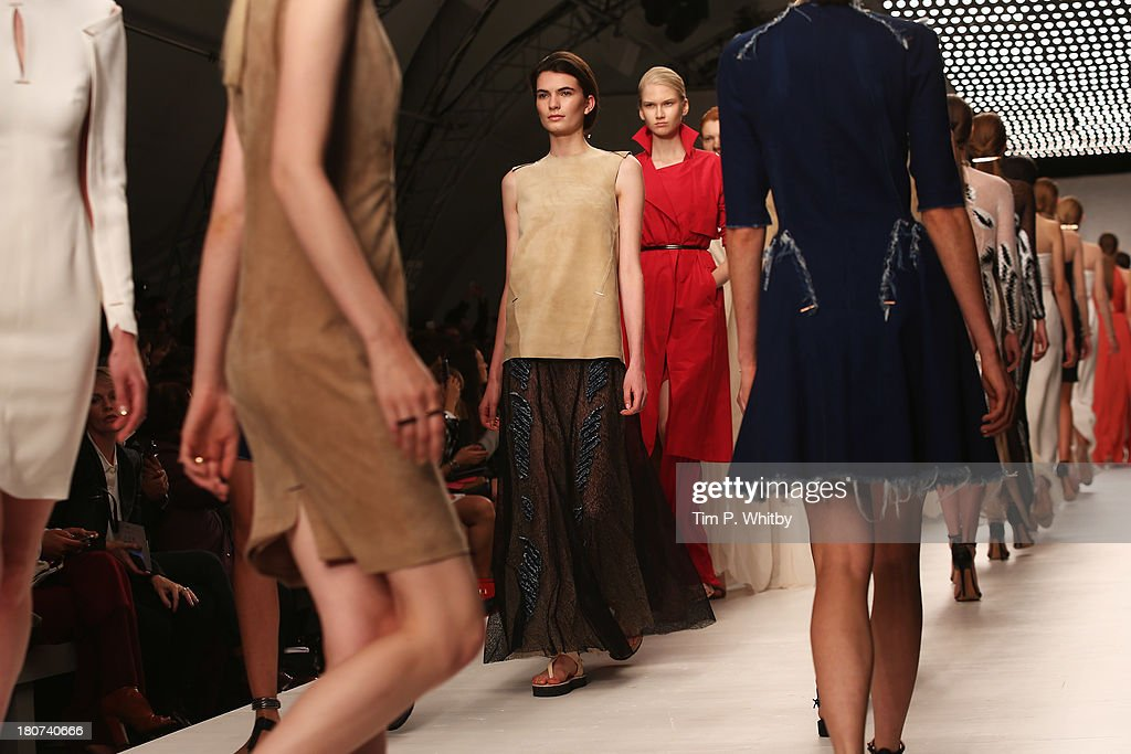 Models walk the runway at the Marios Schwab show during London Fashion Week SS14 at TopShop Show Space on September 16, 2013 in London, England.