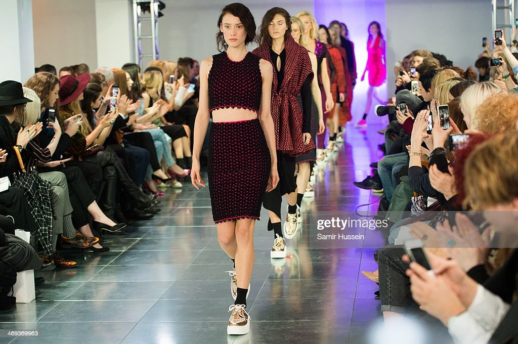 Models walk the runway at the Mark Fast show at London Fashion Week AW14 at Aldwych House on February 14, 2014 in London, England.