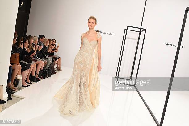 Models walk the runway at the Mark Zunino For Kleinfeld show during New York Fashion Week Bridal at Kleinfeld on October 6 2016 in New York City