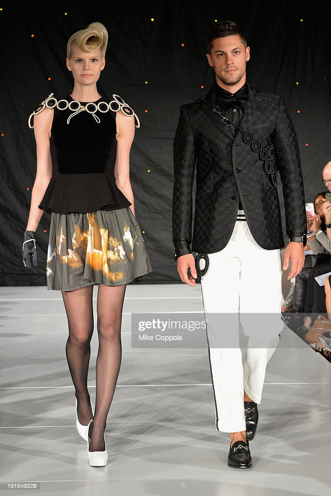 Models walk the runway at the Marlon Gobel Spring 2013 fashion show during MercedesBenz Fashion Week at the New York Public Library on September 8...