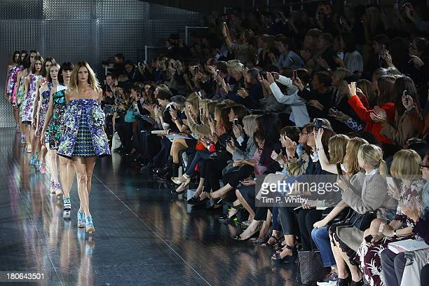 Models walk the runway at the Mary Katrantzou show during London Fashion Week SS14 at on September 15 2013 in London England