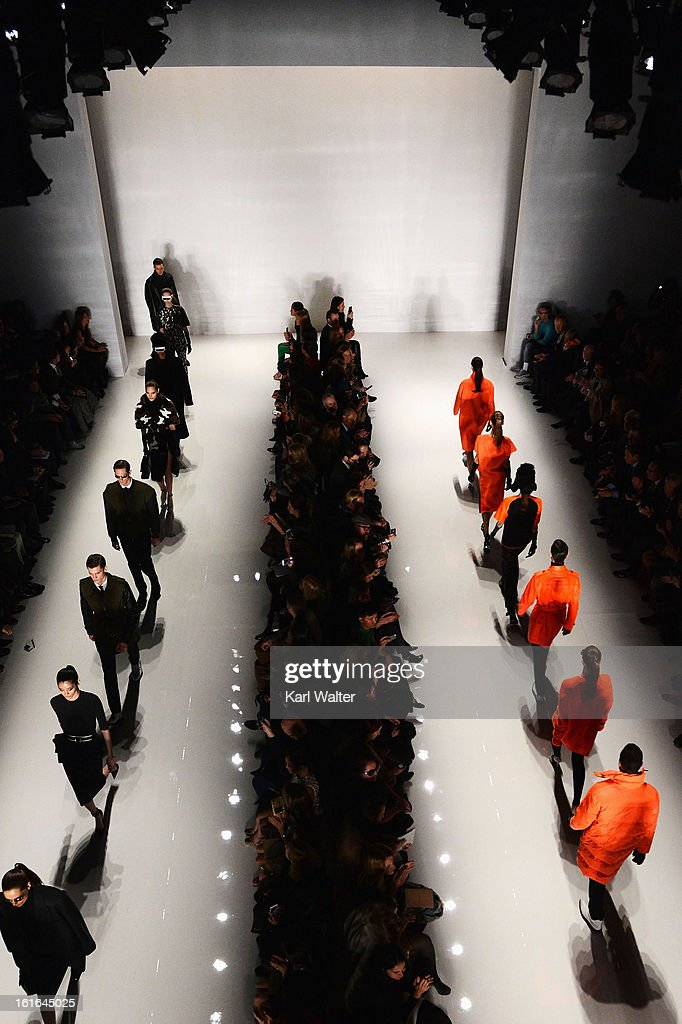 Models walk the runway at the Michael Kors fashion show during Fall 2013 Mercedes-Benz Fashion Week at Lincoln Center for the Performing Arts on February 13, 2013 in New York City.