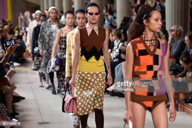 Models walk the runway at the Miu Miu Spring Summer 2018 fashion show during Paris Fashion Week on October 3 2017 in Paris France