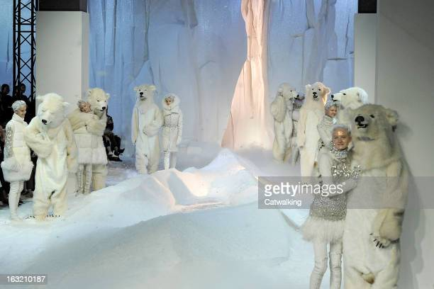 Models walk the runway at the Moncler Gamme Rouge Autumn Winter 2013 fashion show during Paris Fashion Week on March 6 2013 in Paris France