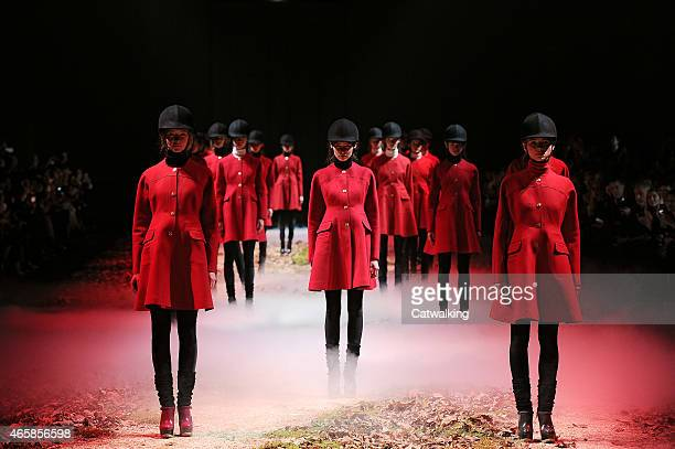Models walk the runway at the Moncler Gamme Rouge Autumn Winter 2015 fashion show during Paris Fashion Week on March 11 2015 in Paris France