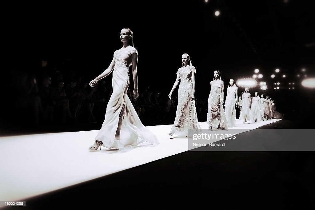 Models walk the runway at the Monique Lhuillier Fashion show during Mercedes-Benz Fashion Week Spring 2014 on September 7, 2013 in New York City.