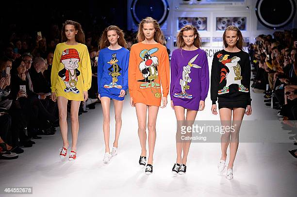 Models walk the runway at the Moschino Autumn Winter 2015 fashion show during Milan Fashion Week on February 26 2015 in Milan Italy