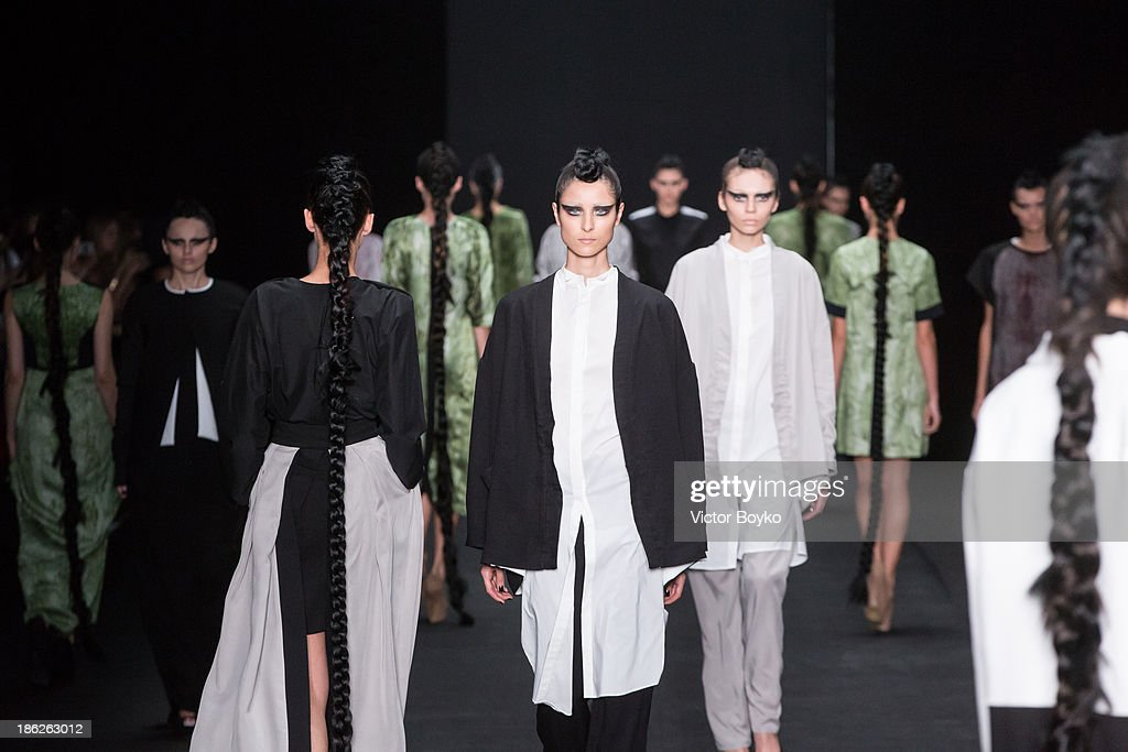 Models walk the runway at the Muscovites by Mashsa Kravtsova show of Mercedes-Benz Fashion Week S/S 14 on October 29, 2013 in Moscow, Russia.