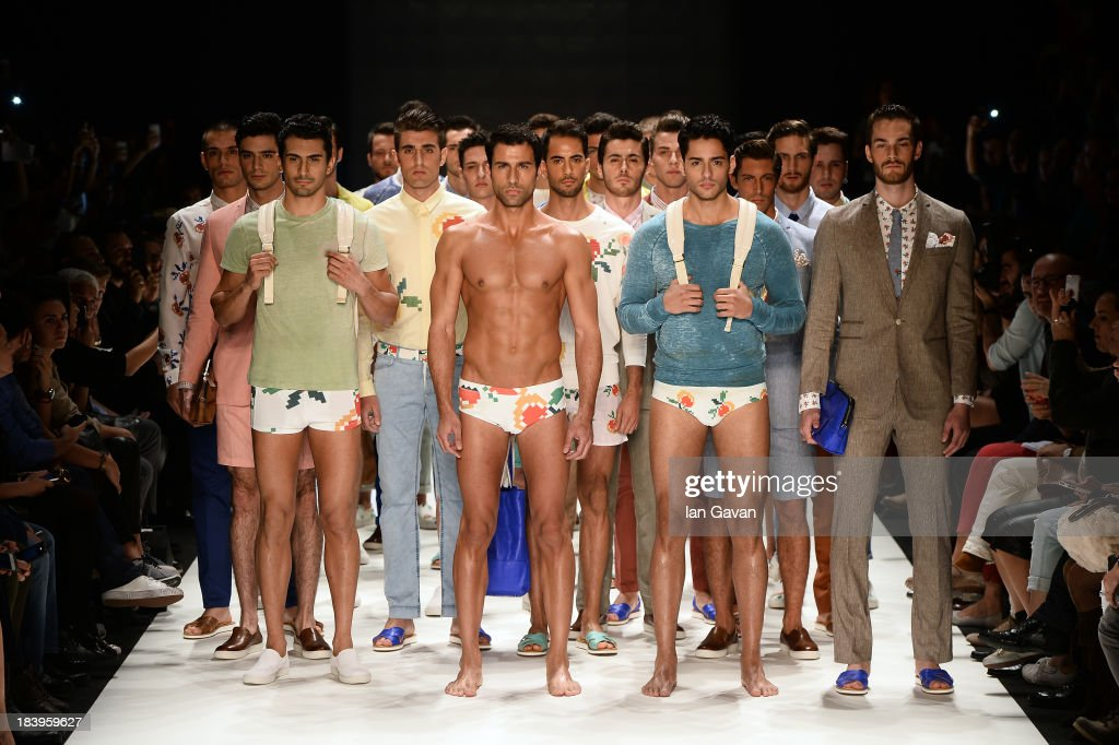 Models walk the runway at the Niyazi Erdogan show during Mercedes-Benz Fashion Week Istanbul s/s 2014 Presented By American Express on October 10, 2013 in Istanbul, Turkey.