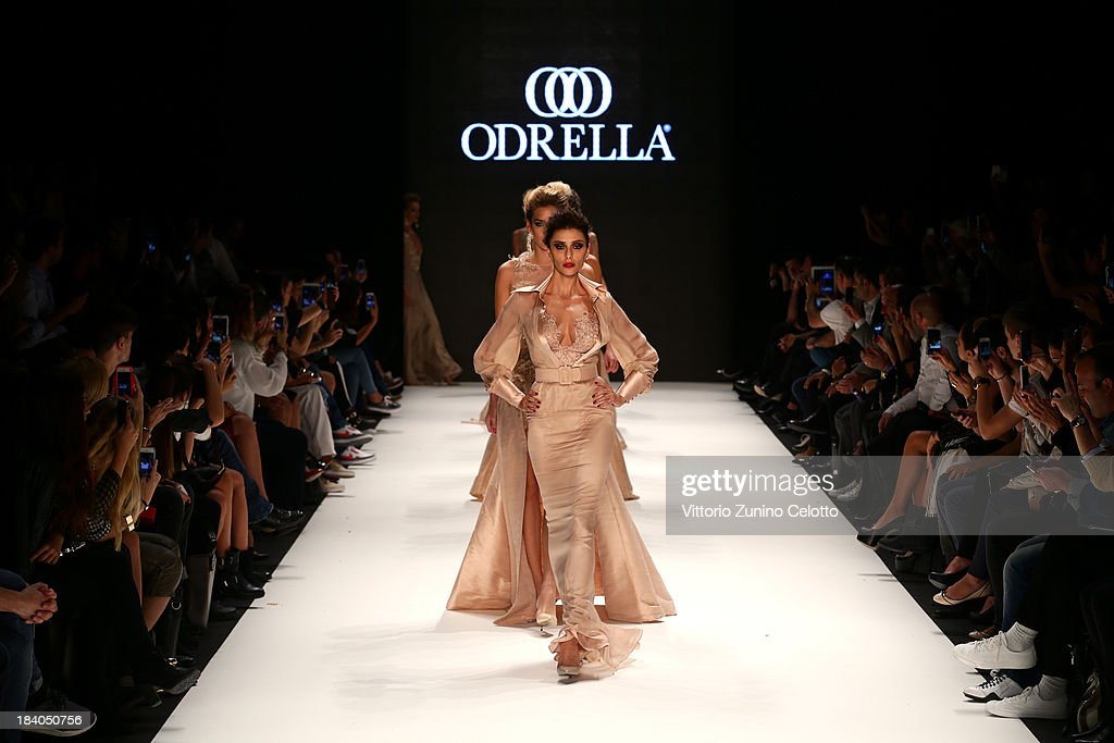 Models walk the runway at the Odrella show during Mercedes-Benz Fashion Week Istanbul s/s 2014 Presented By American Express on October 11, 2013 in Istanbul, Turkey.