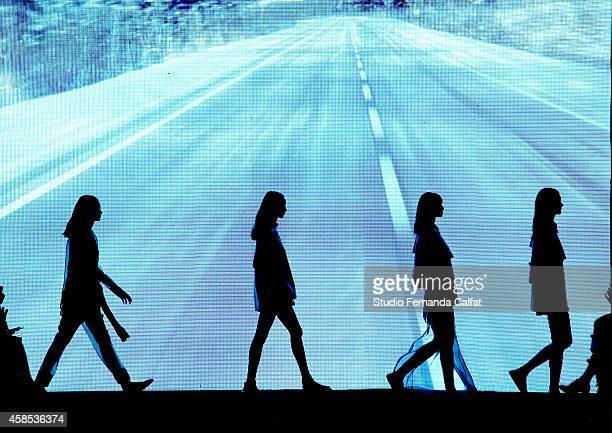 Models walk the runway at the Osklen fashion show during Sao Paulo Fashion Week Winter 2015 at Parque Candido Portinari on November 6 2014 in Sao...