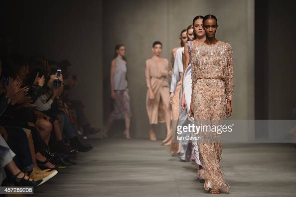 Models walk the runway at the Ozgur Masur show during Mercedes Benz Fashion Week Istanbul SS15 on October 15 2014 in Istanbul Turkey