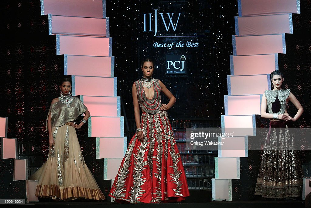Models walk the runway at the PCJ Grand Finale show of India International Jewellery Week 2012 day 5 at the Grand Hyatt on August 23, 2012 in Mumbai, India.