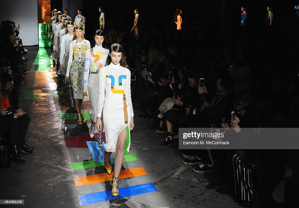 Models walk the runway at the Peter Pilotto show during London Fashion Week Fall/Winter 2015/16 at The Old Sorting Office on February 23 2015 in...