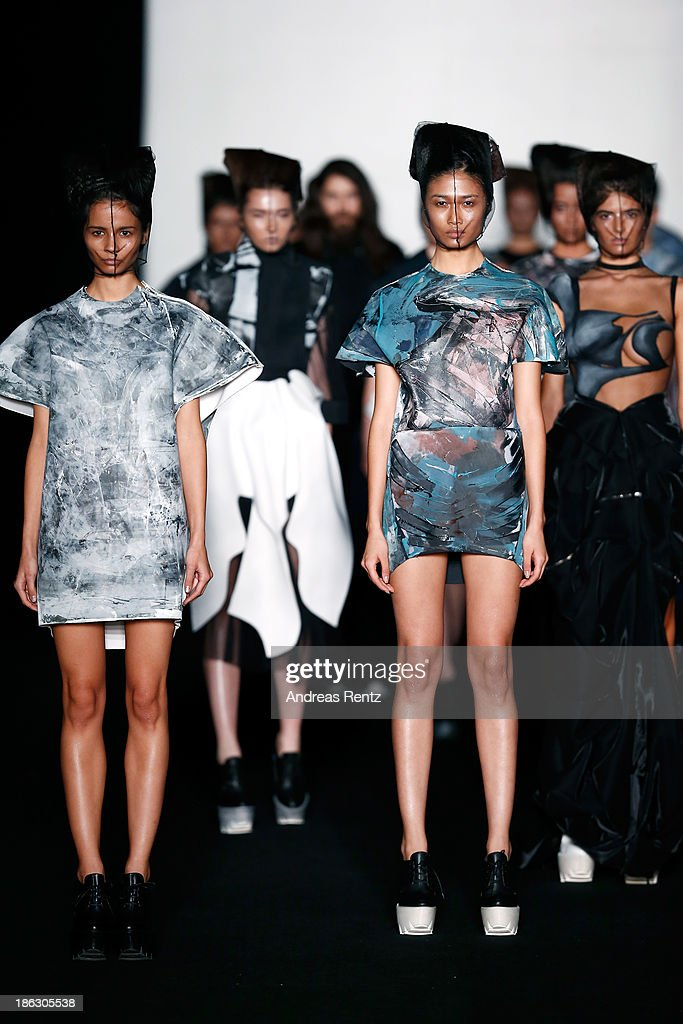 Models walk the runway at the PIROSMANI BY JENYA MALYGINA show during Mercedes-Benz Fashion Week Russia S/S 2014 on October 30, 2013 in Moscow, Russia.