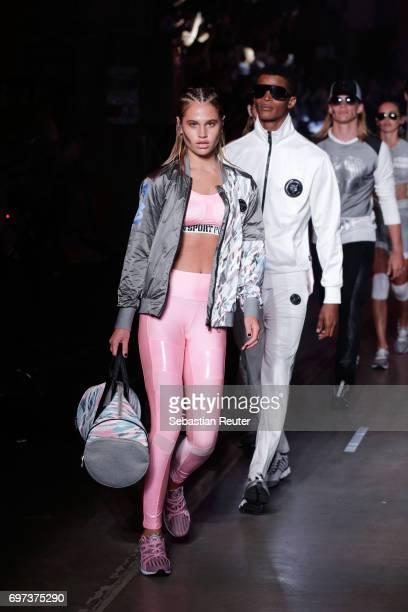 Models walk the runway at the Plein Sport show during Milan Men's Fashion Week Spring/Summer 2018 on June 18 2017 in Milan Italy