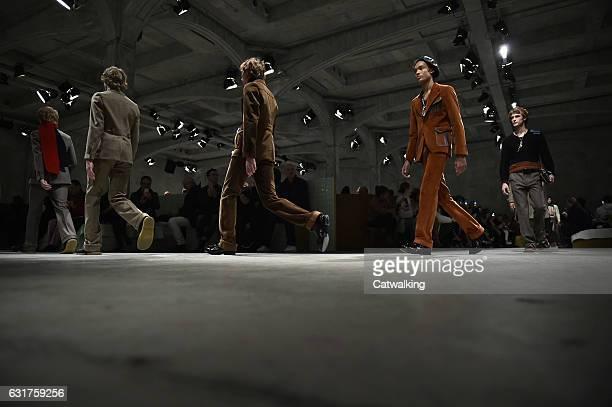 Models walk the runway at the Prada Autumn Winter 2017 fashion show during Milan Menswear Fashion Week on January 15 2017 in Milan Italy