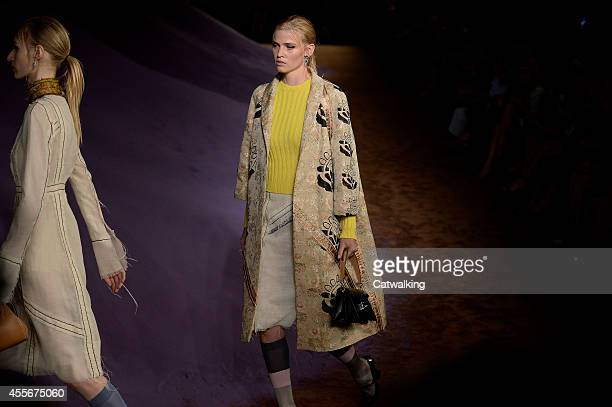 Models walk the runway at the Prada Spring Summer 2015 fashion show during Milan Fashion Week on September 18 2014 in Milan Italy