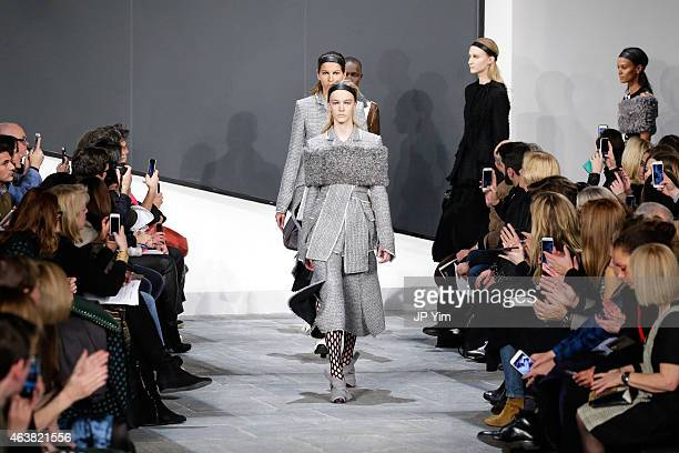 Models walk the runway at the Proenza Schouler show during MercedesBenz Fashion Week Fall 2015 at the Marcel Breuer Building on February 18 2015 in...