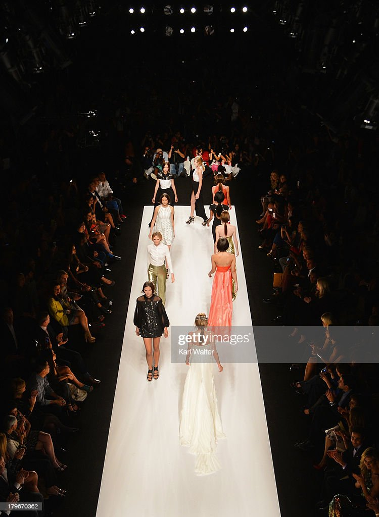 Models walk the runway at the Project Runway Spring 2014 fashion show during Mercedes-Benz Fashion Week Spring 2014 on September 6, 2013 in New York City.