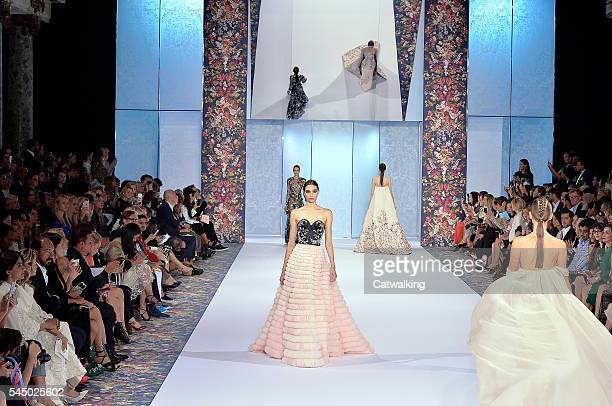 Models walk the runway at the Ralph Russo Autumn Winter 2016 fashion show during Paris Haute Couture Fashion Week on July 4 2016 in Paris France