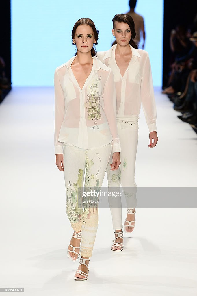 Models walk the runway at the Red Beard By Tanju Babacan show during Mercedes-Benz Fashion Week Istanbul s/s 2014 presented by American Express on October 8, 2013 in Istanbul, Turkey.