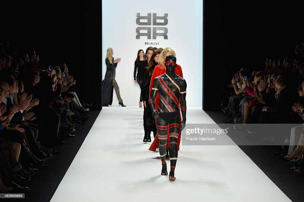 Models walk the runway at the Riani show during Mercedes-Benz Fashion Week Autumn/Winter 2014/15 at Brandenburg Gate on January 14, 2014 in Berlin, Germany.