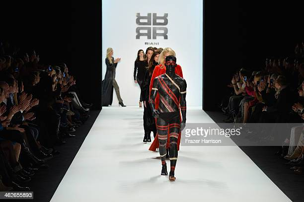 Models walk the runway at the Riani show during MercedesBenz Fashion Week Autumn/Winter 2014/15 at Brandenburg Gate on January 14 2014 in Berlin...