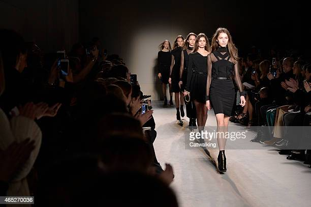 Models walk the runway at the Roland Mouret Autumn Winter 2015 fashion show during Paris Fashion Week on March 5 2015 in Paris France