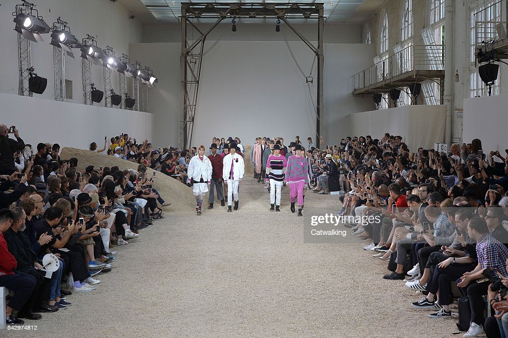 Models walk the runway at the Sacai Spring Summer 2017 fashion show during Paris Menswear Fashion Week on June 25, 2016 in Paris, France.
