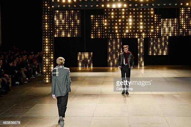 Models walk the runway at the Saint Laurent Autumn Winter 2014 fashion show during Paris Menswear Fashion Week on January 19 2014 in Paris France