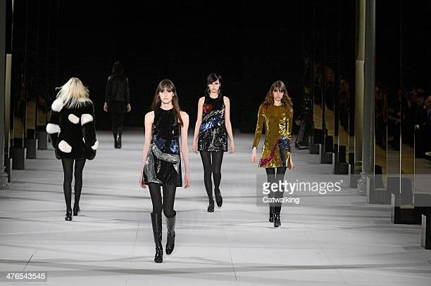 Models walk the runway at the Saint Laurent Autumn Winter 2014 fashion show during Paris Fashion Week on March 3 2014 in Paris France