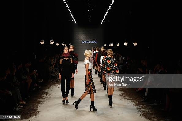 Models walk the runway at the Seyma Subasi show during Mercedes Benz Fashion Week Istanbul SS15 at Antrepo 3 on October 18 2014 in Istanbul Turkey