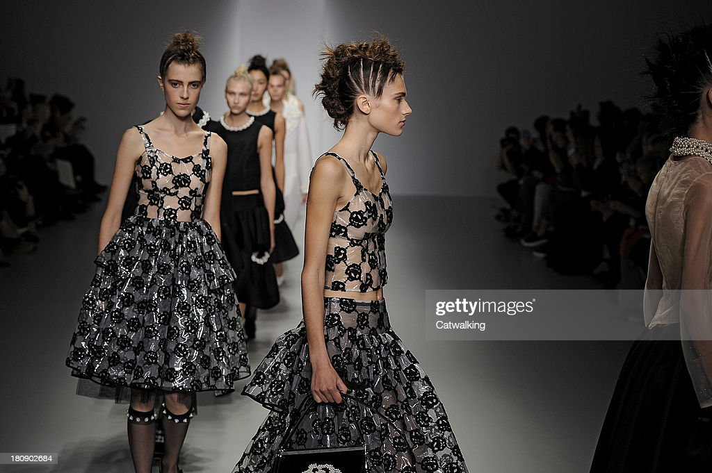 Models walk the runway at the Simone Rocha Spring Summer 2014 fashion show during London Fashion Week on September 17, 2013 in London, United Kingdom.