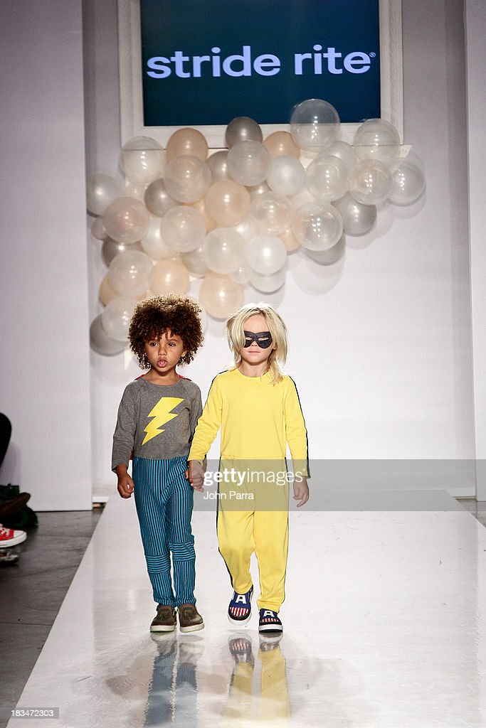 Models walk the runway at the Stride Rite Children's Group Fashion Showcase at petitePARADE on October 6, 2013 at Industria Superstudios in New York City.