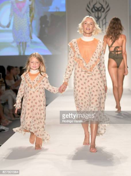 Models walk the runway at the SWIMMIAMI HotAsHell 2018 Collection fashion show at 227 22nd Street on July 21 2017 in Miami Beach Florida