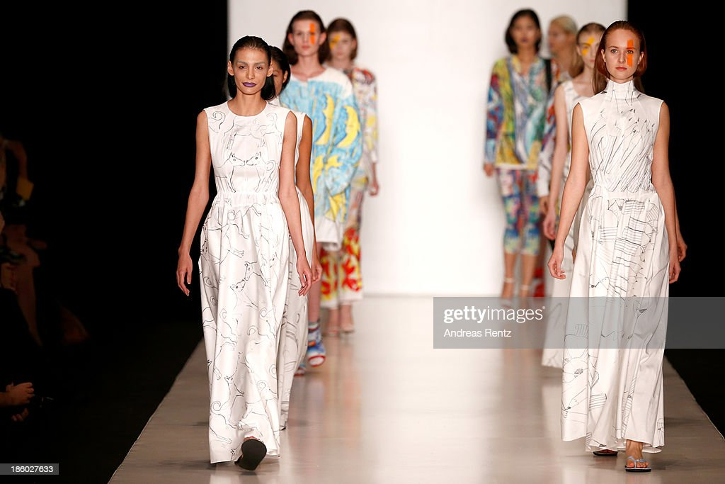 Models walk the runway at the Tatyana Parfionova show during Mercedes-Benz Fashion Week Russia S/S 2014 on October 27, 2013 in M