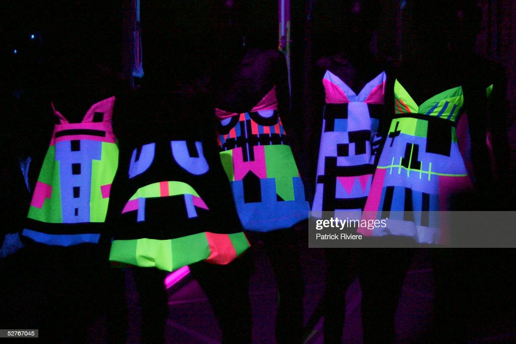 Models walk the runway at the Tsubi collection presentation under black light at the Overseas Passenger Terminal during the Mercedes Australian...