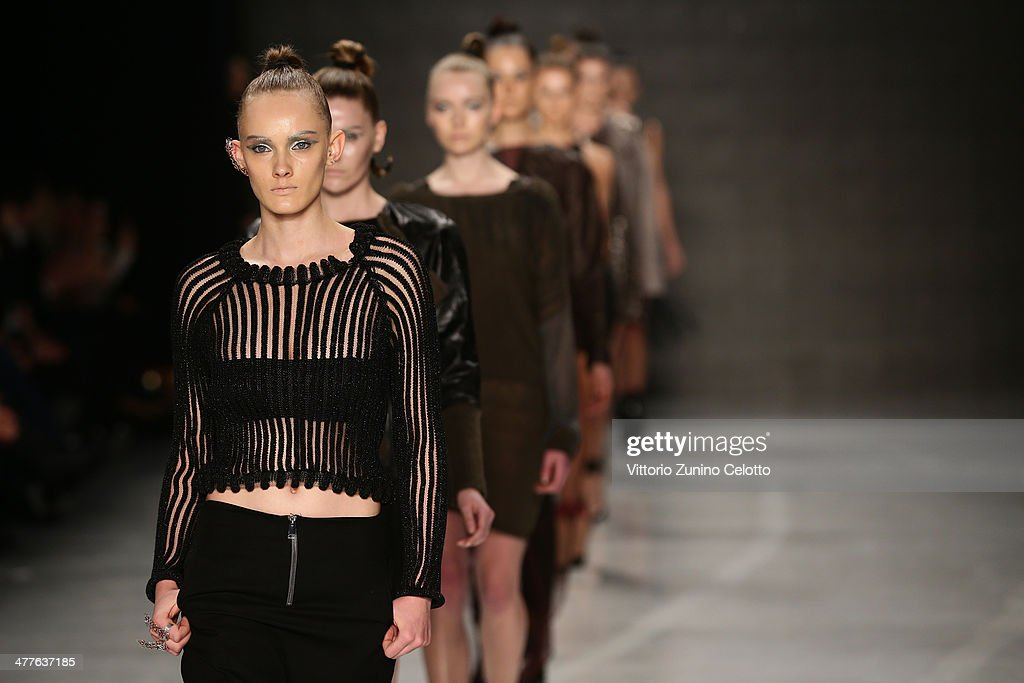 Models walk the runway at the Tuba Ergin show during MBFWI presented by American Express Fall/Winter 2014 on March 10, 2014 in Istanbul, Turkey.